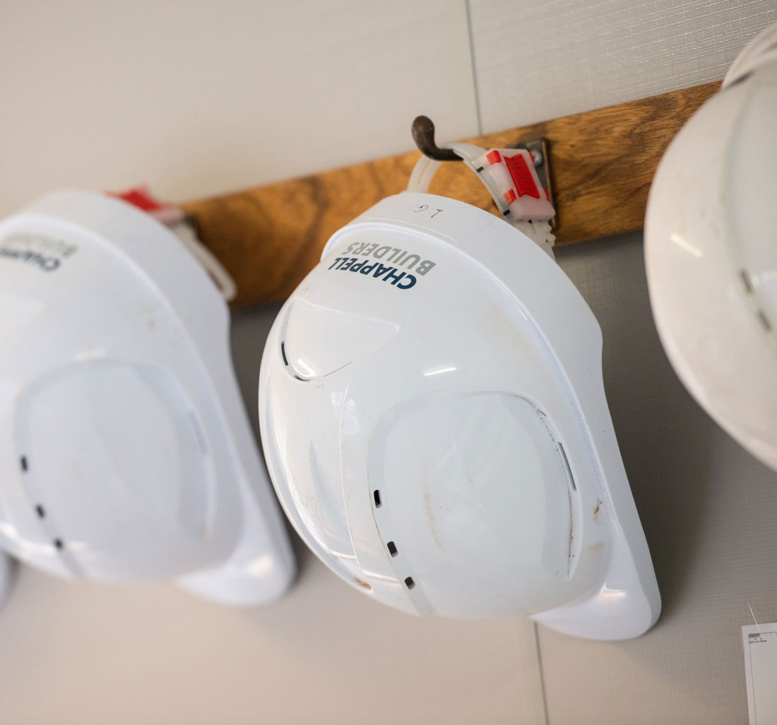 Chappell Builders hard hats on coat hooks