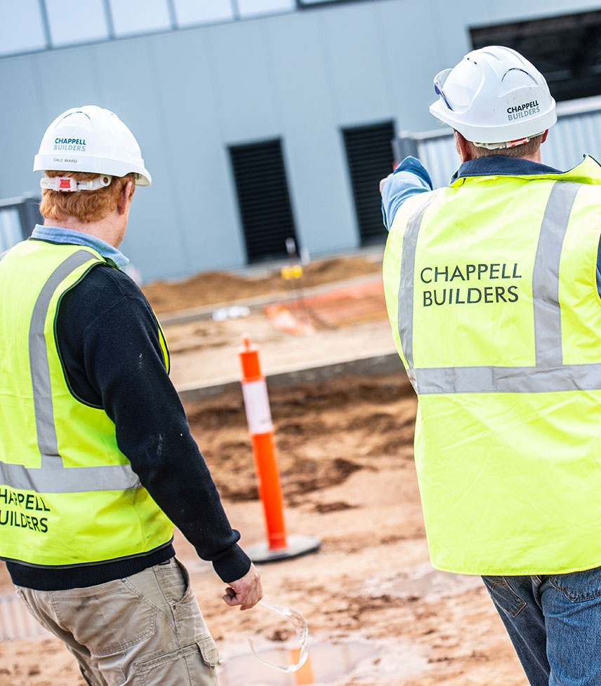 Chappell Builders staff waring high visibility clothing, working on job site