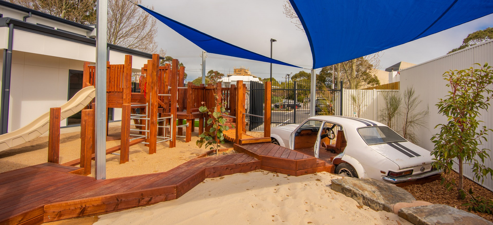 Children's playground with sandpit and wooden climbing equipment