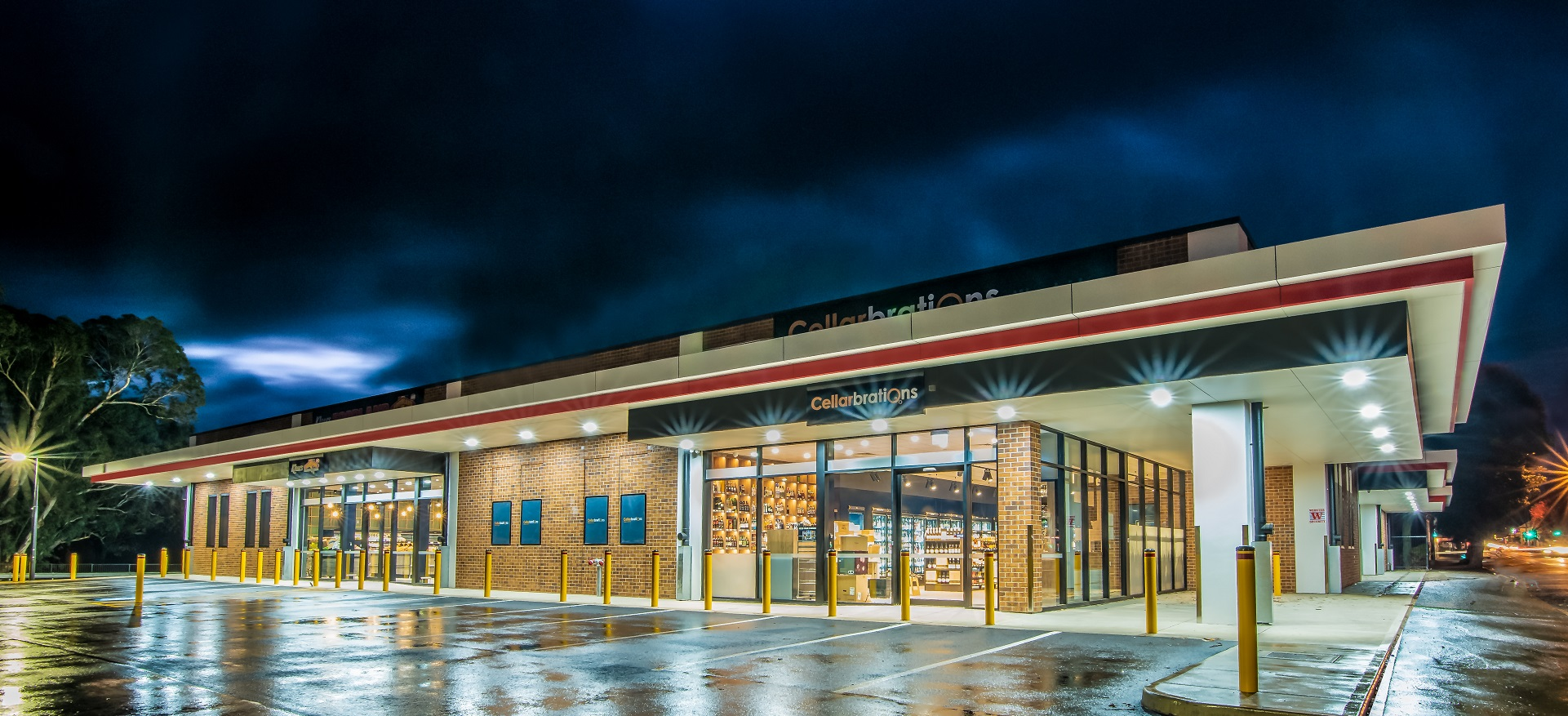 Exterior of supermarket lit up at night